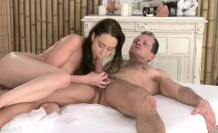 Brunette gets oiled breasts massaged and cunt banged