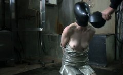 BDSM sub with airtight mask caddle prodded