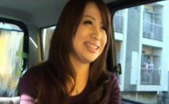 Japanese milf patting his crotch