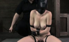 Cruel master humiliates a mask wearing female slave