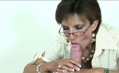 Lady Sonia gobbles and tugs cock