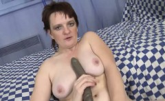 Old Mature masturbates with thin and long dildo