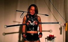 Brunette juggy stands terrible torture in her master dungeon