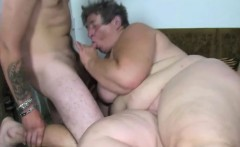 Fat woman fucks herself with a dildo