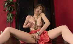 Busty Japanese, Ai Sakura, plays with pussy in solo
