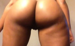 Curvaceous caramel babe twerking her big round booty for th
