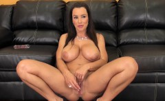 Big tit MILF Lisa sits on her couch while fingering and toying her snatch