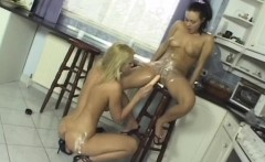 two lusty lesbians lube up with whipped cream for a dildo fucking party