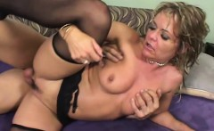 Curvaceous blonde mom in black stockings gets pounded by a young stud