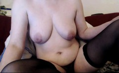 Busty nympho in black stockings toys her hungry snatch on t