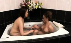 sultry japanese babes caressing each other's bodies in the