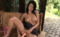 Young raven-haired sweetie loves masturbating outside