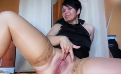 Lustful brunette cougar with big hooters fingers her pussy