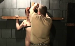 redhead pale babe big boobs tied to cross dungeon