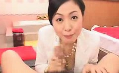Elegant Japanese lady with a pretty smile worships a fat co