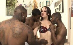 brunette woman dped by massive black cocks on the couch