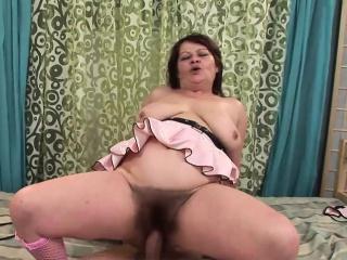 Fat mature slut rides a stiff cock