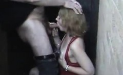 Adult lady within the alleyway in red