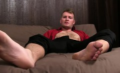 Relaxed fellow gets feet and toe sucked while jerking off.