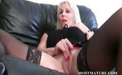 Blonde lesbo rubs her mature snatch