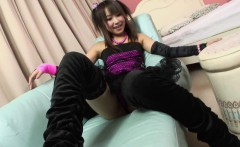 Playful gravure idol poses in sexy clothes and reveals pussy