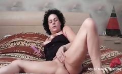 Lusty sexy mature using vibrator to reach orgasm