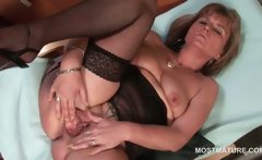 Sexy blonde mature wide spreading her pink snatch