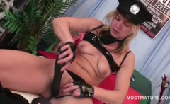 Blonde mature teasing her fuck hole with a big dildo