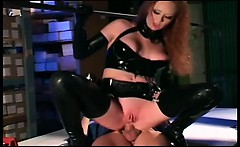 Sexy redhead getting fucked in shiny black latex