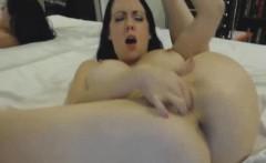 Big tit amateur fucks pussy with a dildo