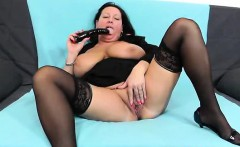 Horny housewife pleasing with her plastic penis
