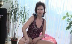 Sexy redhead mature touches her hot assets