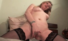 Stockinged mature having a taste of her cunt