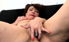 Hairy mature pleasures herself on the sofa
