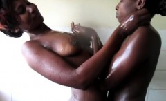 Soapy African Lesbians cuddling in the shower while washing.