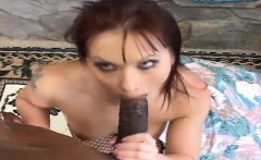 Busty redhead in fishnet stockings buries a black dick inside her ass
