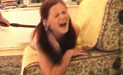 Petite redhead with pigtails bends over and relishes a hard spanking