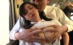 Enticing Asian girl with perky boobs kneels down and blows