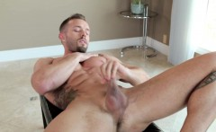 Ripped athlete tugging his cock