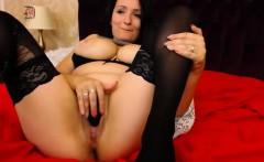 Bodacious brunette in stockings Zyana pleases her slit on t