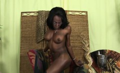 Bigtitted black tgirl in boots tugging cock
