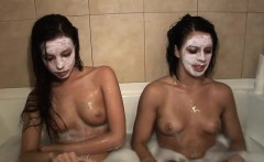 Two teens have fun in the bathroom