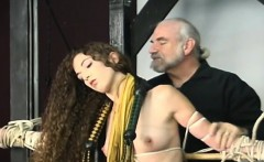 Woman endures heavy servitude sex at home in video