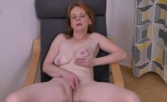 Euro milf Elisabeth strips off and rubs her shaven cunt
