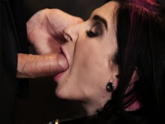 Latex wearing secretary Joanna Angel earns anal pleasure