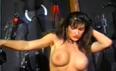 Busty dyke domina stretching subs tight ass with a strapon