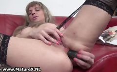 Dirty mature wife loves to stick a dildo