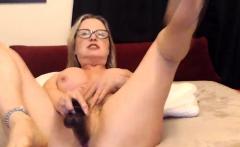 Horny GILF enjoys double dildo penetration