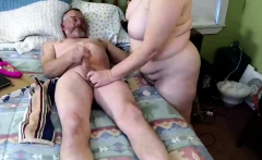 Mature milf in glasses giving handjob to lucky guy in POV