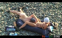 Voyeur on public beach. Oral sex
